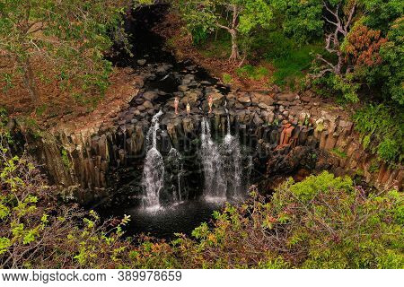 Family On The Background Of The Rochester Waterfall On The Island Of Mauritius From A Height.waterfa