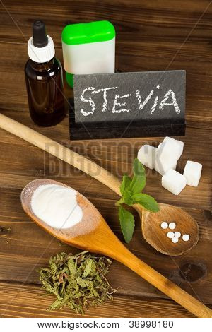 Healthy sweetener stevia in liquid tablet dried and powder forms, plus real sugar lumps