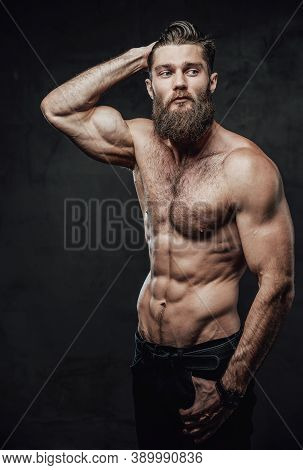 Cool And Haired Shirtless Man With Beard And Moustache In Pants Posing With Hand In Pockets And Hand