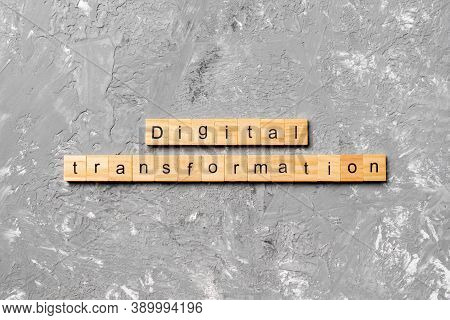 Digital Transformation Word Written On Wood Block. Digital Transformation Text On Cement Table For Y
