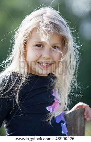 Closeup Portrait Of Happy Small Caucasian Girl With Wild Hair
