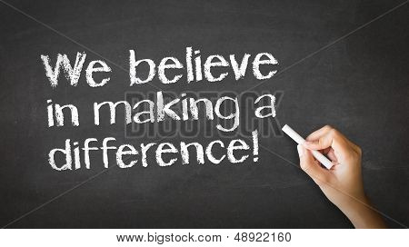 A person drawing and pointing at a We believe in making a difference Chalk Illustration poster