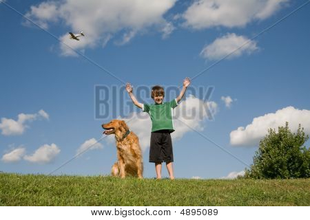 Boy Raising Arms