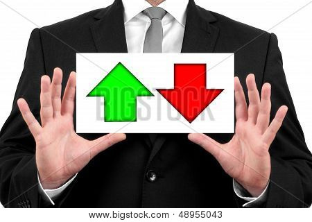 Decreases and increases in stock market, exchange rates, up and down.Businessman shows business card