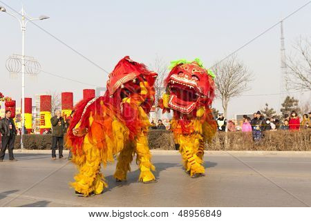 YU COUNTY CHINA FEBRUARY 5: People performing traditional lion dance for celebrating Lantern Festival on February 5 2012 in Yu County, China.