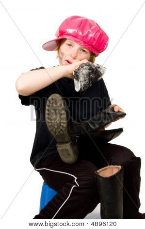 Little Bootblack Girl Is Shining Up The Shoes