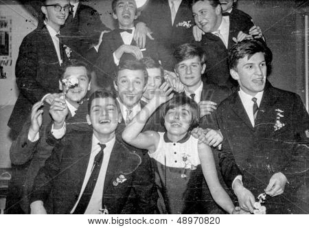 LODZ, POLAND CIRCA SIXTIES - vintage photo of group of high school pupils parting together, Lodz, Poland circa sixties