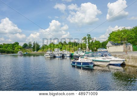 CONG, IRELAND - JUNE 06: boats moor in port near Cong village on Lake Corrib, Cong,  Ireland on June 06, 2013
