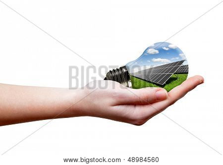 Bulb with of solar panel in hand isolated on white