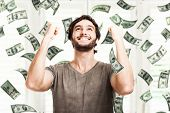 Portrait of a very happy young man in a rain of money poster
