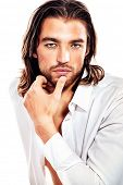 Portrait of a handsome man in an unbuttoned white shirt. Isolated over white. poster