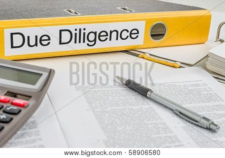 A yellow folder with the label Due Diligence