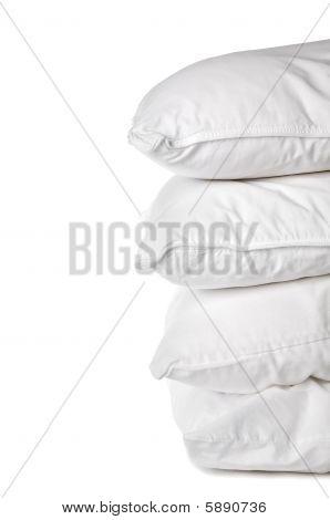 A Stack Of 4 White Pillowcases On White
