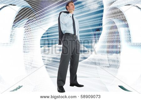 Serious businessman holding his jacket against abstract white design on blue and white