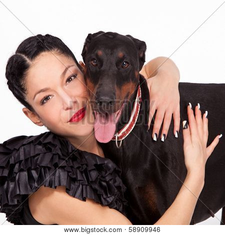 woman hugging her dog studio shot  poster