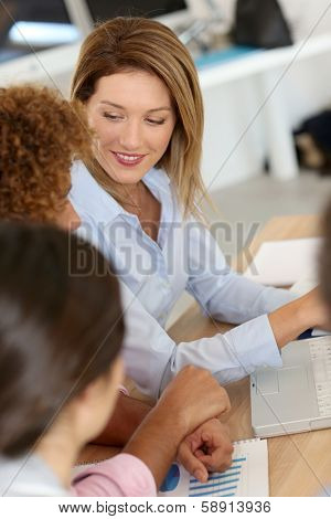 Businesswoman in meeting with workmates