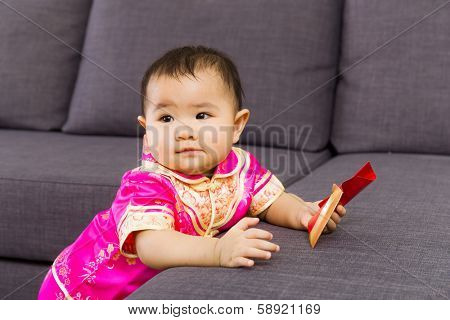 Chinese baby holding red pocket