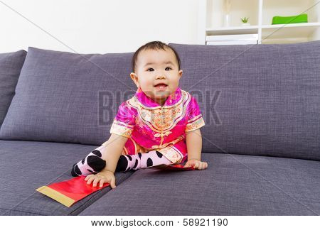 Chinese baby touching red pocket