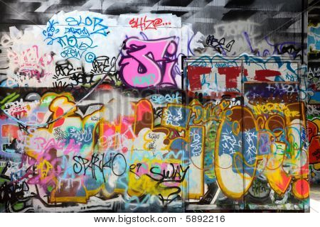 Abstract colorful graffiti background in a wall