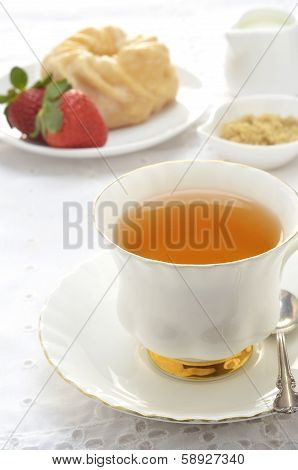 Tea  With Glazed Cruller And Strawberries
