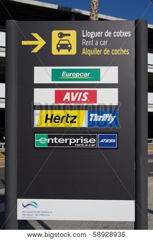 VALENCIA, SPAIN - JANUARY 21, 2014: A rental car sign at the Valencia airport. The rental car industry is a 31 billion dollar industry worldwide with Hertz having 28% of the market share.