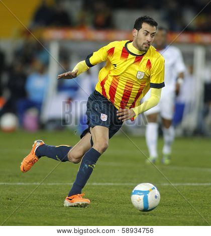 BARCELONA - DEC, 30: Catalan player Sergio Busquets of FC Barcelona in action during the friendly match between Catalonia and Cape Verde at Olympic Stadium on December 30, 2013 in Barcelona, Spain