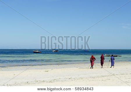 Zanzibar Nungwi Beach, Tanzania, Africa 11 December 2013 : Group of male Masai on a beautiful Zanzibar beach in traditional clothes.