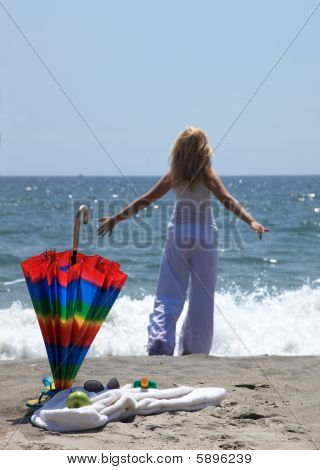 Young Woman Enjoing On A Beach