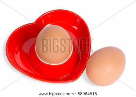 Isolated Egg In A Red Heart-shaped Eggcup