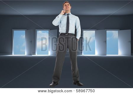 Smiling businessman holding his jacket against doors opening in dark room to show sky
