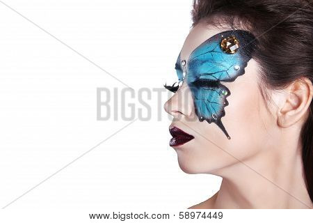 Color Face Art Portrait. Fashion Make Up. Butterfly Makeup On Face Beautiful Woman. Isolated On Whit