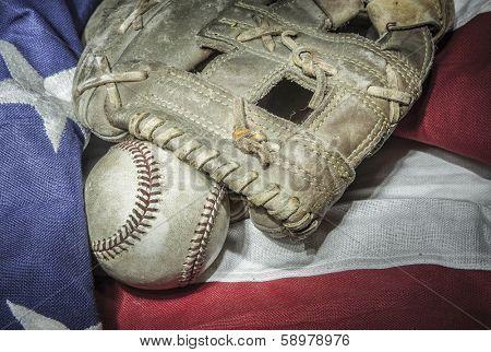 major league baseball with American flag and glove