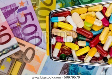 tablets, shopping cart, euro bills, symbolic photo for pharmaceuticals, health insurance, health care costs