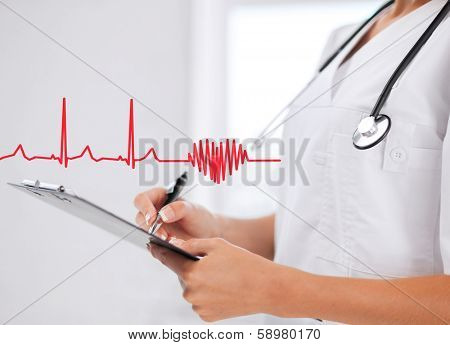 healthcare and medical concept - female doctor with stethoscope writing prescription poster