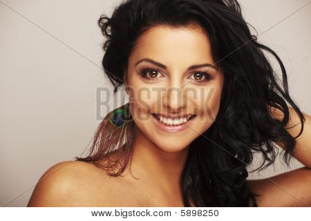 Beautiful Brunette Model In Studio On Light Background