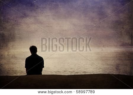 Man looking out over the Pacific ocean
