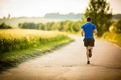 Male athlete/runner running on road - jog workout well-being concept poster