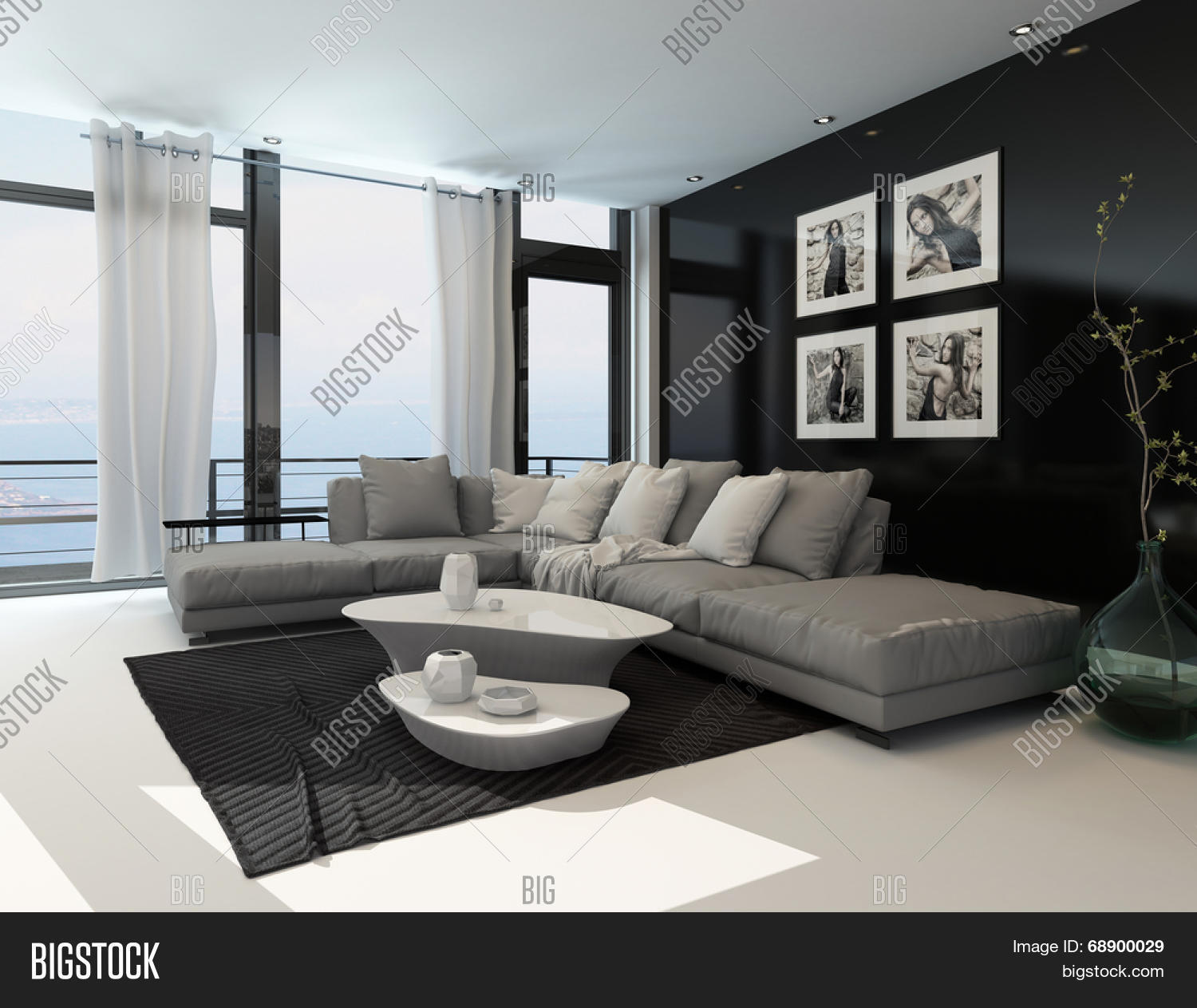 Lounge interior with a dark accent wall and floor to ceiling window overlooking the