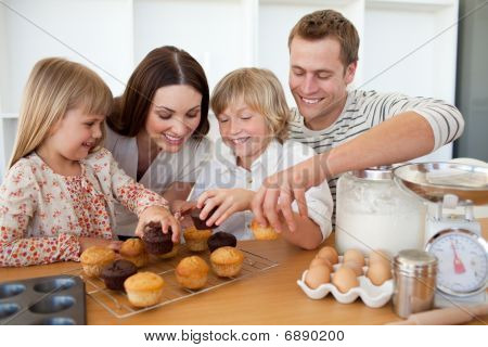 Loving Family Eating Their Muffins