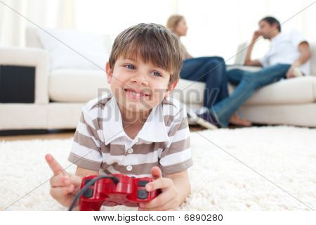 poster of Smiling Little Boy Playing Video Games at home