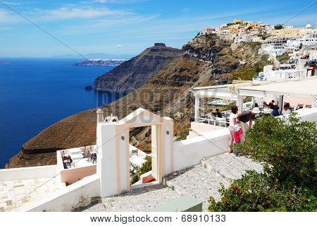 Fira, Greece - May 17: The View On Fira Town And Tourists Enjoying Their Vacation On May 17, 2014 In