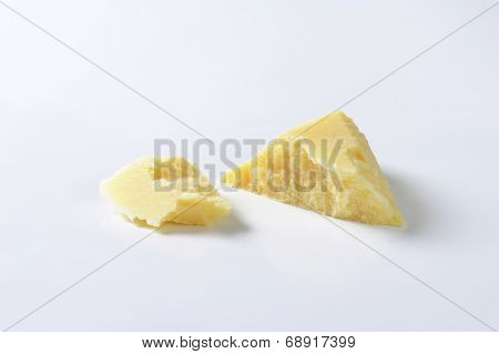 two shreds of italian parmesan cheese
