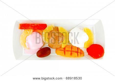 ice cream on pineapple with mango on plate