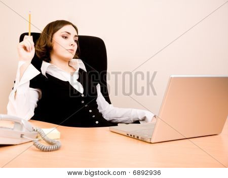 Young Businesswoman Sitting In The Chair