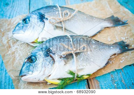 Two Raw Dorado Fishes With Lemon, And Dill