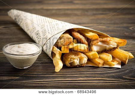 Fish & Chips On Wooden Table