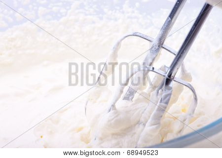 Whipping Cream In A Glass Bowl