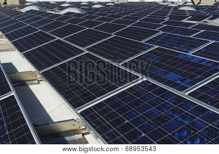 Solar Panels at solar power plant against clear sky