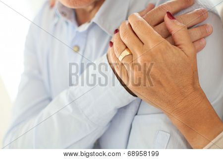 Closeup of senior people's hands held togehter