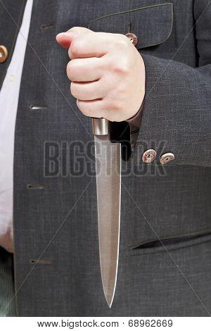 Kitchen Knife In Businessman Hand